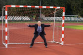Businessman defending goal — Stock Photo