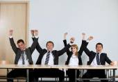 Business people punching air — Stock Photo