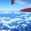 View from the plane over mountains — Stock Photo #75994943