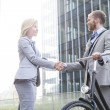 Businesspeople shaking hands — Stock Photo #75994719