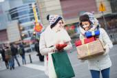 Women with gifts and shopping bags — Stock Photo