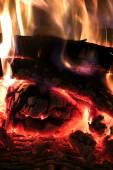 Crest of flame on burning wood — Stock Photo