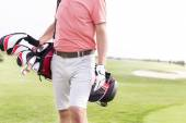 Man with golf club bag standing — Stock Photo