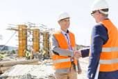 Engineers shaking hands — Stock Photo