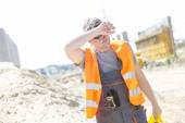 Construction worker wiping forehead — Stock Photo