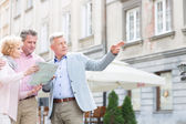 Man assisting to middle-aged couple — Stock Photo
