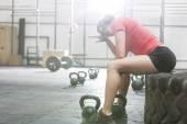 Woman sitting on tire — Stock Photo