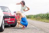 Women looking at damaged cars — Stock Photo