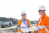 Engineers discussing at construction site — Stock Photo