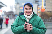 Man in winter clothing smiling — Stock Photo