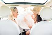 Friends reading map in car — Stock Photo