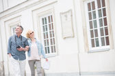 Couple walking arm in arm — Stock Photo