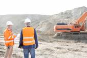 Supervisors standing at construction site — Stock Photo