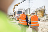 Supervisors walking at construction site — Stock Photo