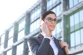 Businesswoman using cell phone — Stock Photo