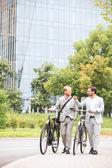 Businessmen talking while walking — Stock Photo