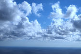 Blue sky with tiny clouds — Stock Photo