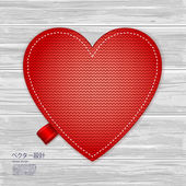 Valentines kniited heart on a wood background — Stock Vector