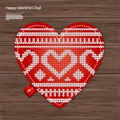 Valentines kniited heart on a wood background — Vetor de Stock