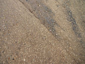 Wet Sand with rocks and dirt — ストック写真