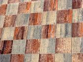 Checked Ceramic rustic tiled floor  — Stock Photo