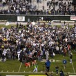 College football celebratetion on the field after end a game — Stock Photo #54162737