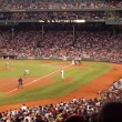 Постер, плакат: Athletics Pitcher throws a pitch to Red Sox batter as he swings
