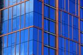 Blue Glass Windows reflect clouds — Stock Photo