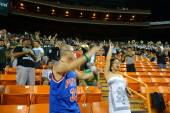 Hawaii fans and marching band cheer for big score in stands at c — Stock Photo