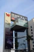 Big Red W and Drais signs with ads for Aziz Ansariand Acura on t — Stock fotografie
