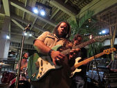 Guidance Band Jams on guitar and drums on stage at Mai Tai Bar — Stock Photo