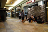 People wait on the floor in line for store opening of Lululemon — Stock Photo