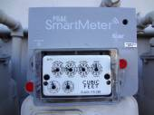 PG&E (utility co) electricity SmartMeters on residential buildin — Stock Photo