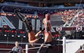 WWE Wrestler Randy Orton backflips Seth Rollins off the top turn — Stock Photo