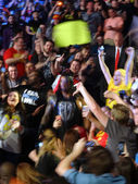 Wrestler Roman Reigns walks through crowd to the ring — Stock Photo