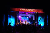 Roothub performs on stage during a evening concert at Wanderlust — Stock Photo