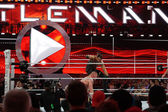 Seth Rollins curb stomps WWE Champion Brock Lesner face into the — Stock Photo