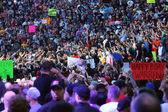 Wrestler Roman Reigns walks through crowd — Stock Photo