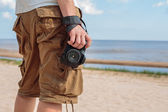 The memory of the holiday and the hot summer - a man and a camera — Stock Photo