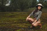 Safari woman in  the morning swamp — Zdjęcie stockowe