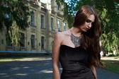 Sexy woman in black dress and necklace — Zdjęcie stockowe