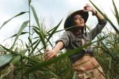 Safari woman in swamp — Stock Photo