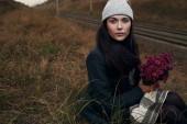 Woman sitting near railway close up — Stock Photo