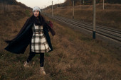 Woman walking near railway — Stock Photo