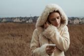 Woman using smartphone close up — Stock Photo
