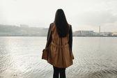 Woman near the river — Stock Photo