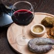 Meat fillet sausage and red wine — Stock Photo #59893283