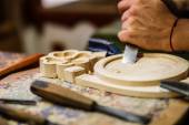 Carpenter hand carving wood with care — Stock Photo