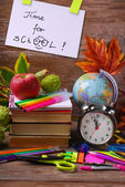 Time for school concept with text on wooden background — Stock Photo