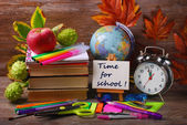 Time for school concept on wooden background — Stock Photo